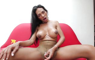 Busty Natalina loves to play with her half-erect tranny dick