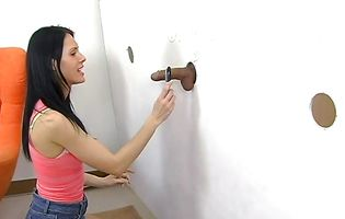 Playful Jennifer Dark tries to get two gloryhole cocks hard