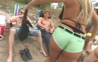 Lucky dudes watch as beach sluts parade their juicy booties