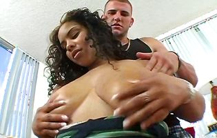Guy squashes babe's huge tits and he really likes it