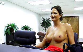 Jolie takes off her shirt and pushes a dildo in
