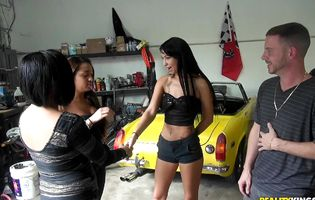 Three horny bitches seduce a hung mechanic in his workshop