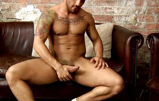 Inked hunk Bruno Bernal eagerly strokes his cock and ass