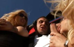 Helicopter pilot Keiran Lee is greeted by two horny bimbos