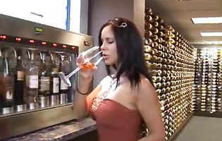 Group of hot babes tastes wine while wearing revealing clothes