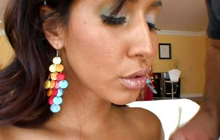 Wicked Isis Love puts a sausage in her moist mouth